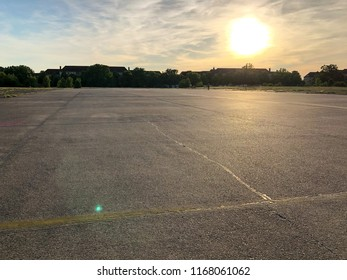 Summer sunset at Tempelhofer Feld, a park at a former airport in Berlin, Germany in 2018.