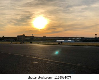Summer sunset at Tempelhofer Feld, a park at a former airport in Berlin, Germany in 2018.