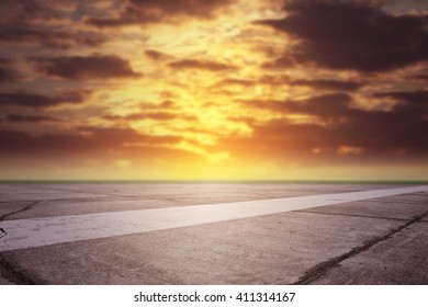 summer sunset time and runway with dark colors of sky