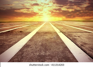 summer sunset time and runway and white marks