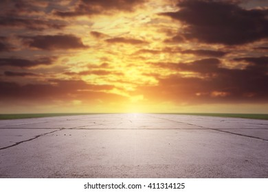 summer sunset time and sun light gray space of runway and grass
