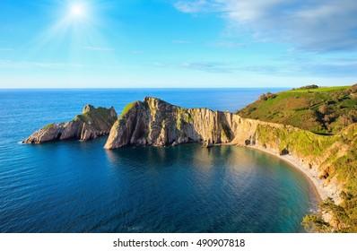 Summer sunshiny top view on Del Silencio (Gaviero) beach (Biscay Bay, Asturias, Spain). Atlantic Ocean coastline landscape.