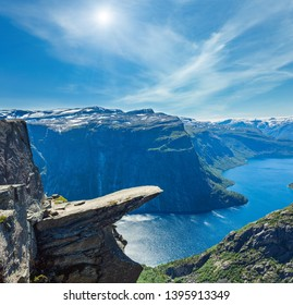 The summer sunshiny view of Trolltunga (famous The Troll tongue Norvegian destination) and Ringedalsvatnet lake in Odda, Roldal, Norway.