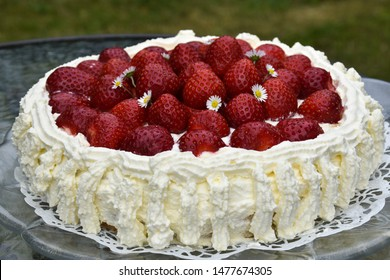 Summer symbol - flower decorated strawberry cake