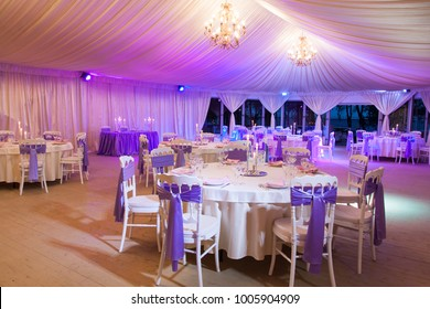 A summer tent with illumination on the wedding day