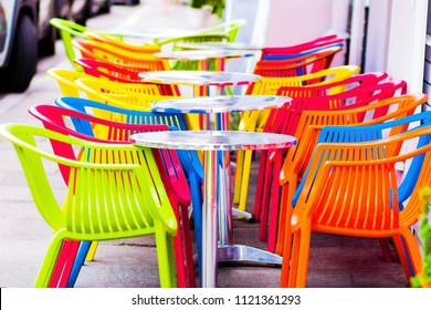 Summer terrace cafe, plastic colorful multi colored chairs outside. Concept food