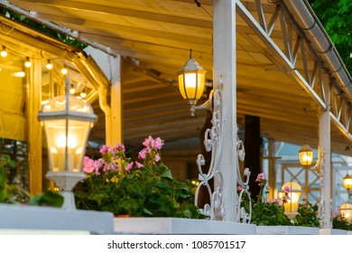 summer terrace with decorative stylized street lamps