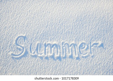 Summer text written on snow for texture or background - winter holiday concept. Sunny day, bright light with shadows, flat lay, top view, clean and nobody