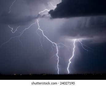 Summer thundershower and lightning over an airplane storage area