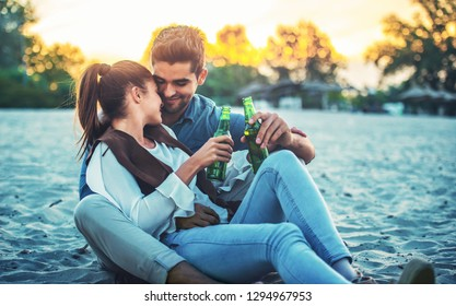 Summer time. Beautiful young couple enjoying in a good mood on the beach. Lifestyle, love, dating, vacation concept