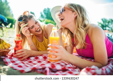Summer time. Beautiful young girls enjoying in a good mood on the beach. Lifestyle, vacation concept