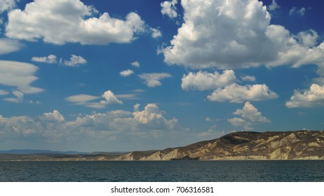 In the summer time.Sea landscape with mountains.