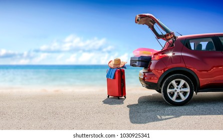 Summer time and red car on beach with few suitcase. Free space for your text or product.