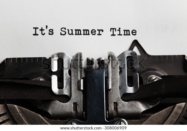 Summer time slogan written by a typewriter on a sheet of a paper