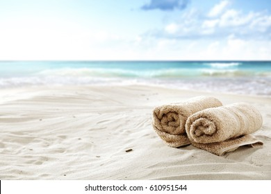 summer time and towel on beach