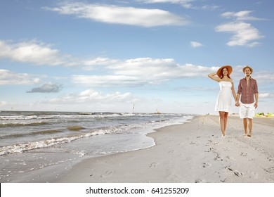 Summer time and two lovers on beach
