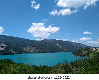Summer time view of the Castillon lake and the village Saint-Julien-du-Verdon in France, Provence