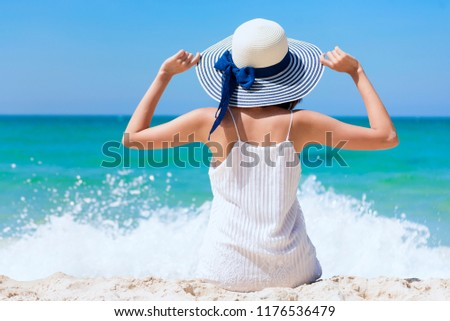 4052868931 Summer time woman vacation on the beach. Cheerful woman wear summer dress  and straw hats