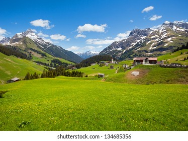 Summer tranquill mountain view to Biberkopf mount (Warth, Vorarlberg, Austria). Beautiful natural vacation hiking walking travel to nature alps destinations concept.