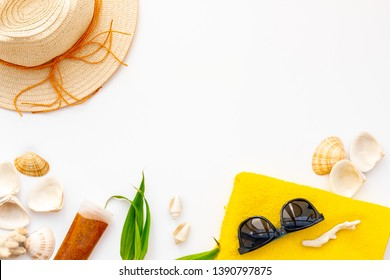 Summer travaling to the sea with straw hat, sun glasses, sunblock lotion on white background top view mock up