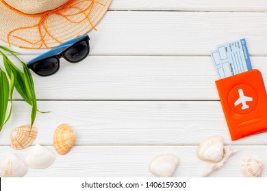 Summer travaling to the sea with straw hat, sun glasses, tickets and passport on white background top view mock up