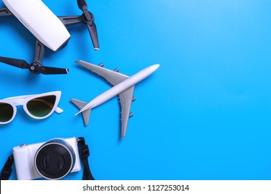 Summer Travel accessories gadget on blue background copy space