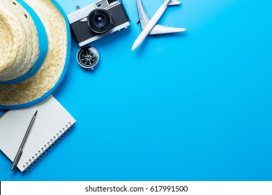 Summer Travel accessories on blue background copy space