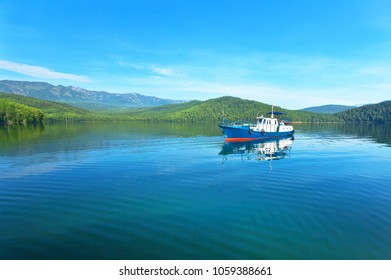 Summer travel by boat in the Chivyrkuiskiy bay of Baikal Lake