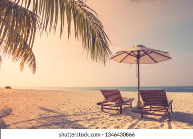 Summer travel destination. Design of summer vacation holiday concept. Perfect tranquil beach scene, soft sunlight and white sand and blue endless sea as tropical landscape