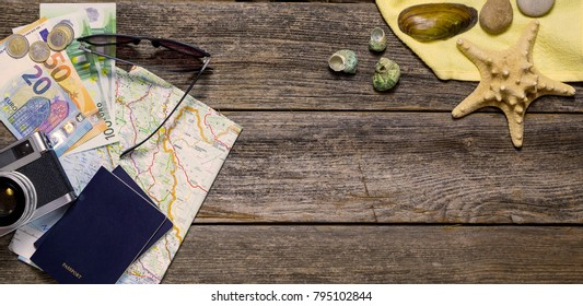 Summer travel stuff on a wooden background with marine details