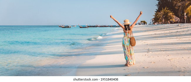 Summer travel vacation concept, Happy traveler asian woman with dress relax and sightseeing on beach in evening at Koh Lipe, Satun, Thailand,