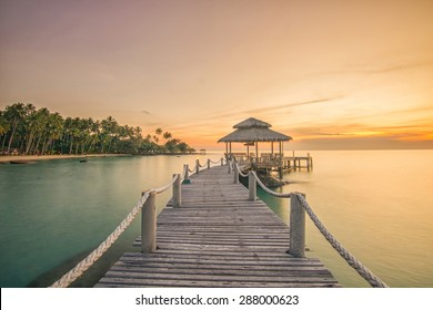 Summer, Travel, Vacation and Holiday concept - Wooden pier between sunset in Phuket, Thailand.