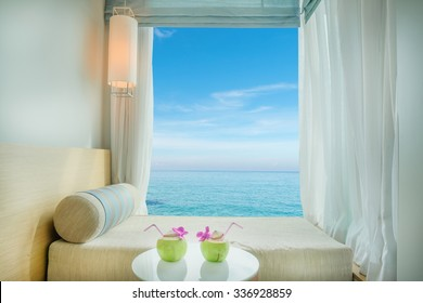Summer, Travel, Vacation and Holiday concept - Beautiful tropical sea view at window in resort, Phuket ,Thailand.
