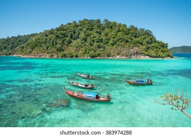 Summer, Travel, Vacation and Holiday concept - Tropical beach, longtail boats at Lipe island in Satun, Thailand