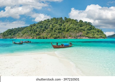 Summer, Travel, Vacation and Holiday concept - Longtale boats at the beautiful beach, Thailand
