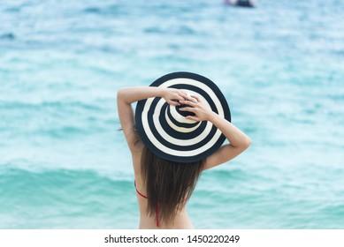 Summer tropical beach island woman backside on the beach