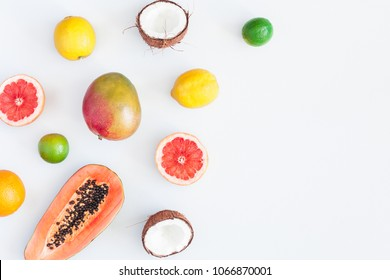 Summer tropical composition. Tropical fruits on gray background. Summer concept. Flat lay, top view, copy space