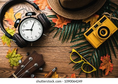 summer vacation background concept with travel stuff items on wooden table background color tone image