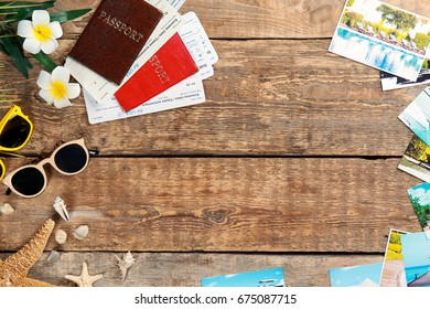 Summer vacation concept. Composition with documents and post cards on wooden background