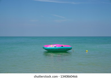 Summer or vacation concept, Inflatable ring or lilo floating in the sea by the beach