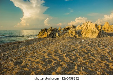 summer vacation concept of Mediterranean sea sand shoreline beach rocky space in evening soft colors golden sunset time and clear weather