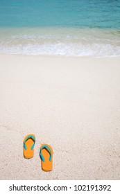 Summer vacation concept--Flipflops on a sandy ocean beach