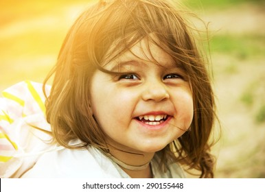 Summer vacation - lovely kid is smiling. Toned.