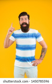 Summer vacation. Man bearded hipster with mustache and long beard on yellow background. Guy dressed striped shirt on summer vacation. Barbershop concept. Summer style. Cheerful sailor. Join my wave.