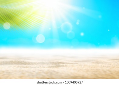 Summer vacation outdoor and travel holiday adventure concept.Copy space blur beautiful nature green palm leaf on tropical beach with bokeh sun light wave abstract background. Vintage tone filter color