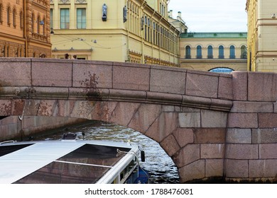 Summer vacation in Saint Petersburg, ship cruise. Excursions along the rivers and canals of the city. Winter groove, the ship passes under the bridge