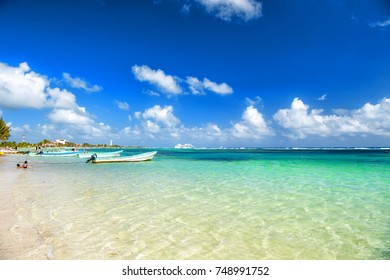 Summer vacation at sea or ocean beach with transparent water and white sand on sunny day on blue sky in Costa Maya, Mexico.