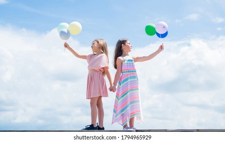 summer vacation. small girls embrace. love and support. concept of sisterhood and friendship. family bonding time. best friends with balloon. two sisters hold party balloon. happy childhood.