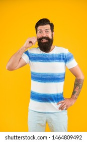 Summer vacation. Summer style. Cheerful sailor. Join my wave. Man bearded hipster with mustache and long beard on yellow background. Guy dressed striped shirt on summer vacation. Barbershop concept.