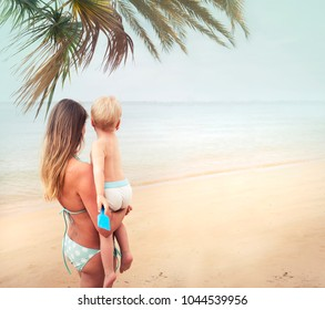 Summer vacation and travel concept/mother and baby on the beach